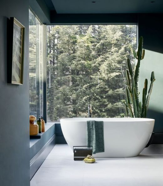 Stunning bathroom with an amazing view of the woods. This is what I call a luxur…