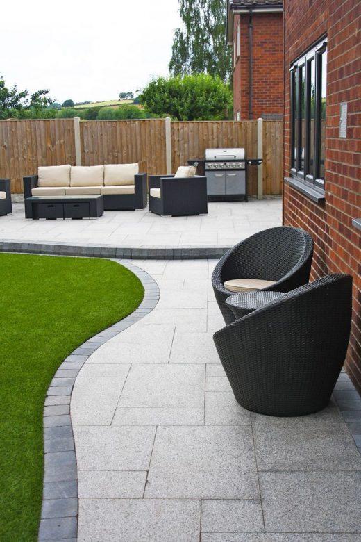 Stunning modern patio | Birch Granite Paving | Contemporary Garden | Wicker Furn…