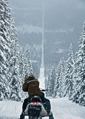 On the road to snow-where! Spectacular shots of snowmobilers riding snowy border between Sweden and Norway
