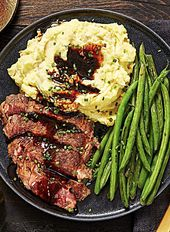 Ribeye and Roasted Garlic Pan Sauce with Mashed Potatoes and Green Beans