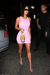 Kim Kardashian highlights her curves in skintight pink dress