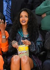 Rihanna shows off her long legs at Lakers game